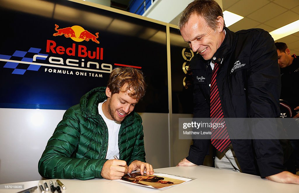<a gi-track='captionPersonalityLinkClicked' href=/galleries/search?phrase=Sebastian+Vettel&family=editorial&specificpeople=2233605 ng-click='$event.stopPropagation()'>Sebastian Vettel</a>, F1 World Champion in 2010, 2011 and 2012 signs autographs at the Red Bull Racing Factory on November 27, 2012 in Milton Keynes, England.