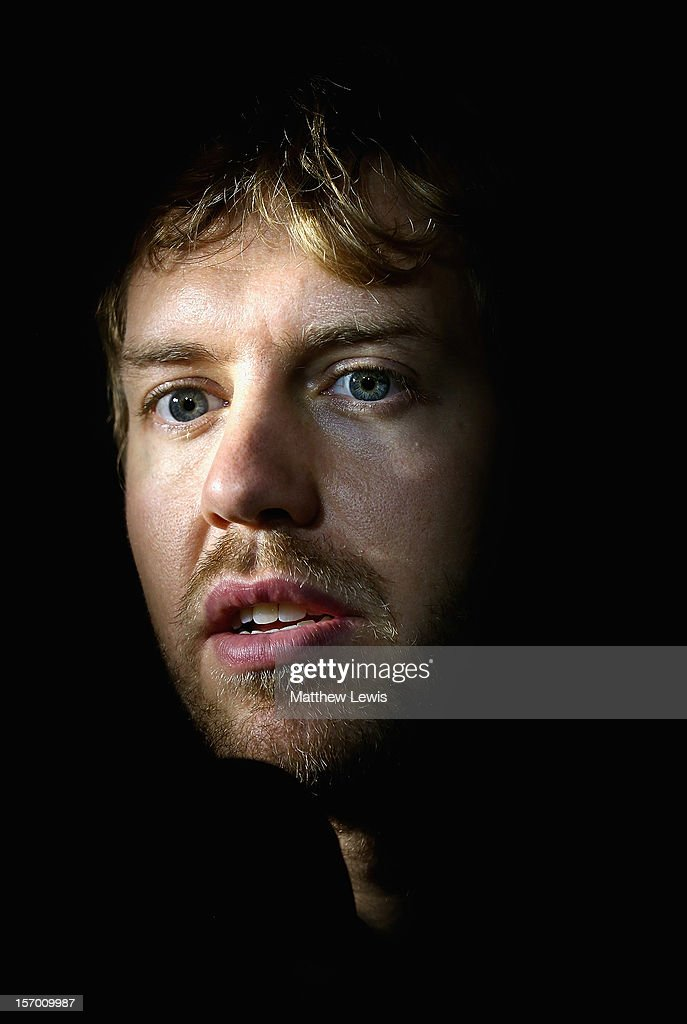 <a gi-track='captionPersonalityLinkClicked' href=/galleries/search?phrase=Sebastian+Vettel&family=editorial&specificpeople=2233605 ng-click='$event.stopPropagation()'>Sebastian Vettel</a>, F1 World Champion in 2010, 2011 and 2012 speaks to the media at the Red Bull Racing Press Conference at the Red Bull Racing Factory on November 27, 2012 in Milton Keynes, England.