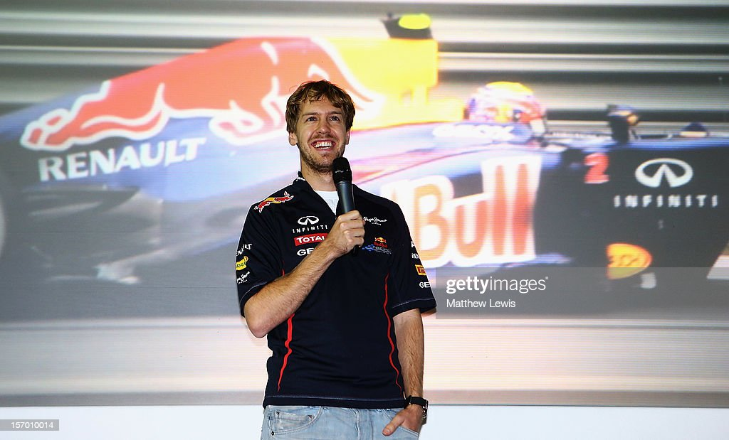 <a gi-track='captionPersonalityLinkClicked' href=/galleries/search?phrase=Sebastian+Vettel&family=editorial&specificpeople=2233605 ng-click='$event.stopPropagation()'>Sebastian Vettel</a>, F1 World Champion in 2010, 2011 and 2012 speaks to factory workers at the Red Bull Racing Factory on November 27, 2012 in Milton Keynes, England.