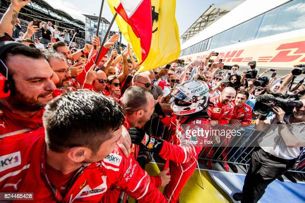 Sebastian Vettel of Ferrari and Germany celebrates winning with his team during the Formula One Grand Prix of Hungary at Hungaroring on July 30 2017...