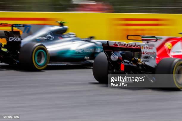 Sebastian Vettel of Ferrari and Germany overtakes Valterri Bottas of Mercedes and Finland during the Spanish Formula One Grand Prix at Circuit de...