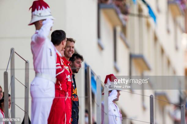 Sebastian Vettel of Ferrari and Germany shares a moment with his Race Engineer Riccardo Adami of Ferrari and Italy he sings the Italian National...