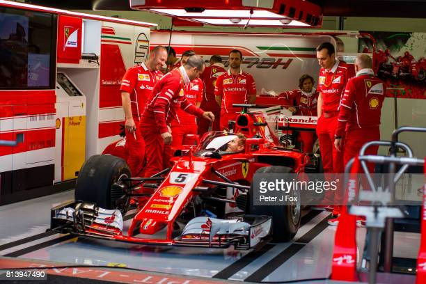 Sebastian Vettel of Ferrari and Germany with the latest FIA crash screen during previews ahead of the Formula One Grand Prix of Great Britain at...