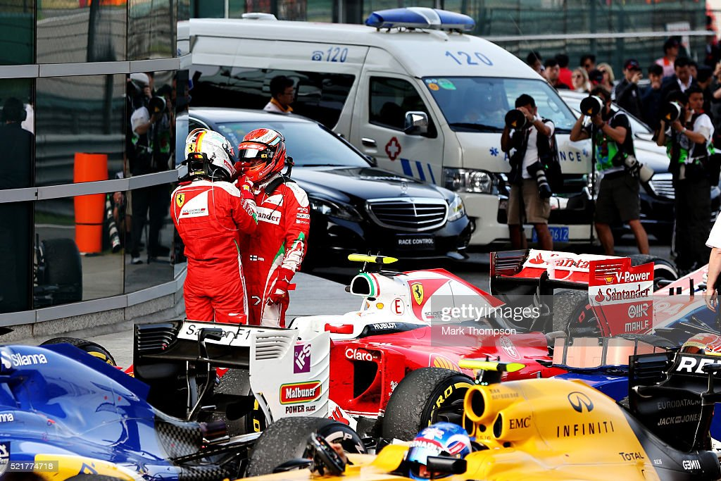 <a gi-track='captionPersonalityLinkClicked' href=/galleries/search?phrase=Sebastian+Vettel&family=editorial&specificpeople=2233605 ng-click='$event.stopPropagation()'>Sebastian Vettel</a> of Germany and Ferrari and Kimi Raikkonen of Finland and Ferrari talk after the race in parc ferme during the Formula One Grand Prix of China at Shanghai International Circuit on April 17, 2016 in Shanghai, China.