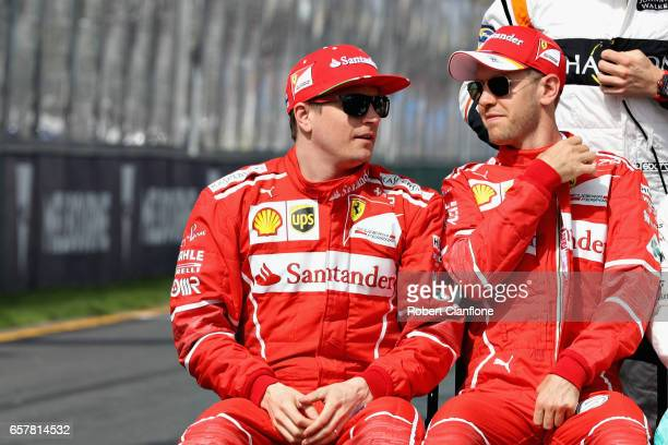 Sebastian Vettel of Germany and Ferrari and Kimi Raikkonen of Finland and Ferrari talk before the F1 Drivers Class of 2017 photo during the...