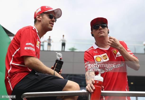 Sebastian Vettel of Germany and Ferrari and Kimi Raikkonen of Finland and Ferrari on the drivers parade before the Formula One Grand Prix of Austria...