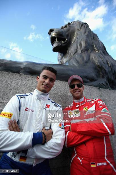 Sebastian Vettel of Germany and Ferrari and Pascal Wehrlein of Germany and Sauber F1 during F1 Live London at Trafalgar Square on July 12 2017 in...