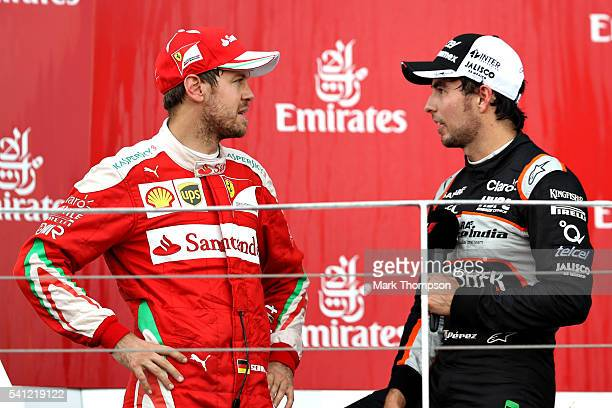 Sebastian Vettel of Germany and Ferrari and Sergio Perez of Mexico and Force India talk on the podium during the European Formula One Grand Prix at...