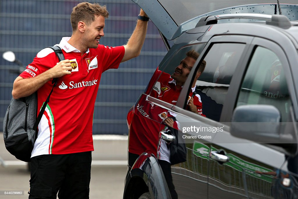 Sebastian Vettel of Germany and Ferrari arrives at the circuit before practice for the Formula One Grand Prix of Austria at Red Bull Ring on July 1, 2016 in Spielberg, Austria.