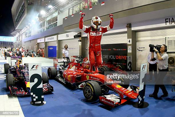 Sebastian Vettel of Germany and Ferrari celebrate sin Parc Ferme after winning the Formula One Grand Prix of Singapore at Marina Bay Street Circuit...