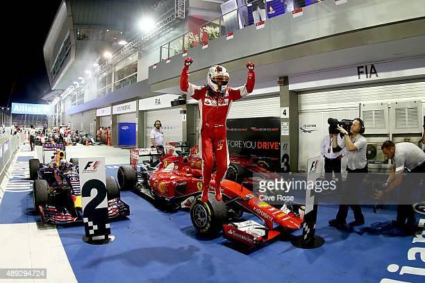 Sebastian Vettel of Germany and Ferrari celebrate sin Parc Ferme after winning the Formula One Grand Prix of Singapore at Marina Bay Street Circuit...