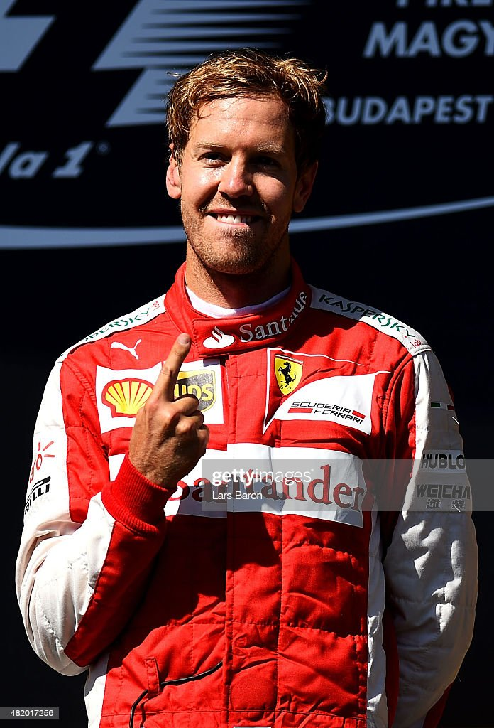 <a gi-track='captionPersonalityLinkClicked' href=/galleries/search?phrase=Sebastian+Vettel&family=editorial&specificpeople=2233605 ng-click='$event.stopPropagation()'>Sebastian Vettel</a> of Germany and Ferrari celebrates after winning the Formula One Grand Prix of Hungary at Hungaroring on July 26, 2015 in Budapest, Hungary.