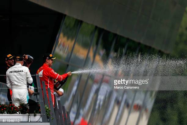 Sebastian Vettel of Germany and Ferrari celebrates finishing in second place on the podium during the Formula One Grand Prix of Austria
