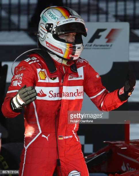 Sebastian Vettel of Germany and Ferrari celebrates his win in parc ferme during the Australian Formula One Grand Prix at Albert Park on March 26 2017...