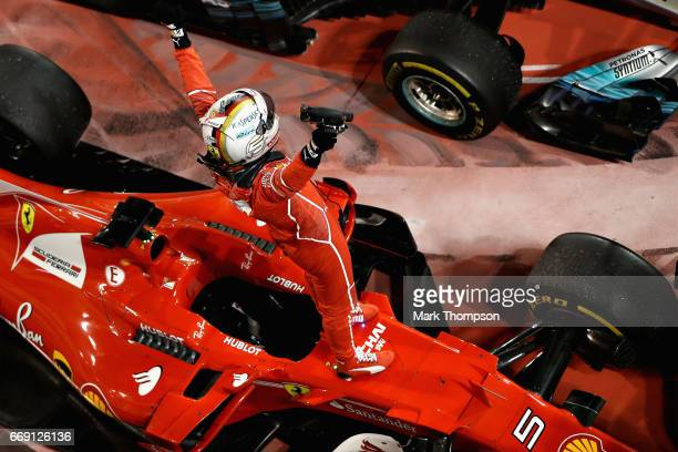 Sebastian Vettel of Germany and Ferrari celebrates his win in parc ferme during the Bahrain Formula One Grand Prix at Bahrain International Circuit...