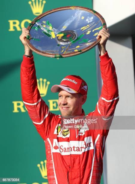 Sebastian Vettel of Germany and Ferrari celebrates his win on the podium during the Australian Formula One Grand Prix at Albert Park on March 26 2017...