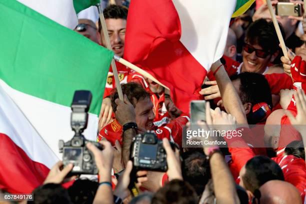 Sebastian Vettel of Germany and Ferrari celebrates his win with the Scuderia Ferrari team during the Australian Formula One Grand Prix at Albert Park...