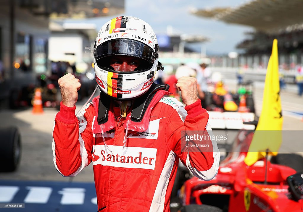 <a gi-track='captionPersonalityLinkClicked' href=/galleries/search?phrase=Sebastian+Vettel&family=editorial&specificpeople=2233605 ng-click='$event.stopPropagation()'>Sebastian Vettel</a> of Germany and Ferrari celebrates in Parc Ferme after winning the Malaysia Formula One Grand Prix at Sepang Circuit on March 29, 2015 in Kuala Lumpur, Malaysia.