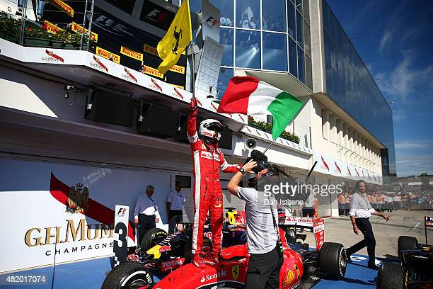 Sebastian Vettel of Germany and Ferrari celebrates in Parc Ferme after winning the Formula One Grand Prix of Hungary at Hungaroring on July 26 2015...