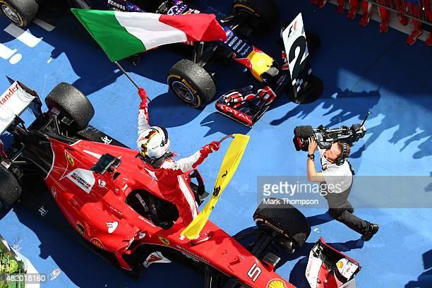Sebastian Vettel of Germany and Ferrari celebrates in Parc Ferme after winning the Formula One Grand Prix of Hungary at Hungaroring on July 26 2015...