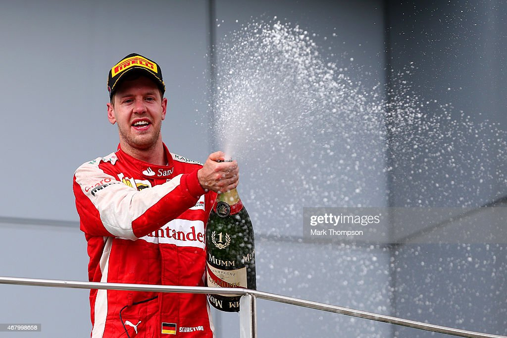 <a gi-track='captionPersonalityLinkClicked' href=/galleries/search?phrase=Sebastian+Vettel&family=editorial&specificpeople=2233605 ng-click='$event.stopPropagation()'>Sebastian Vettel</a> of Germany and Ferrari celebrates on the podium after winning the Malaysia Formula One Grand Prix at Sepang Circuit on March 29, 2015 in Kuala Lumpur, Malaysia.