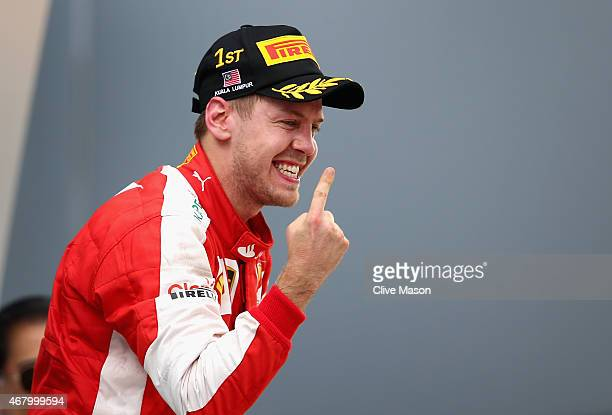 Sebastian Vettel of Germany and Ferrari celebrates on the podium after winning the Malaysia Formula One Grand Prix at Sepang Circuit on March 29 2015...