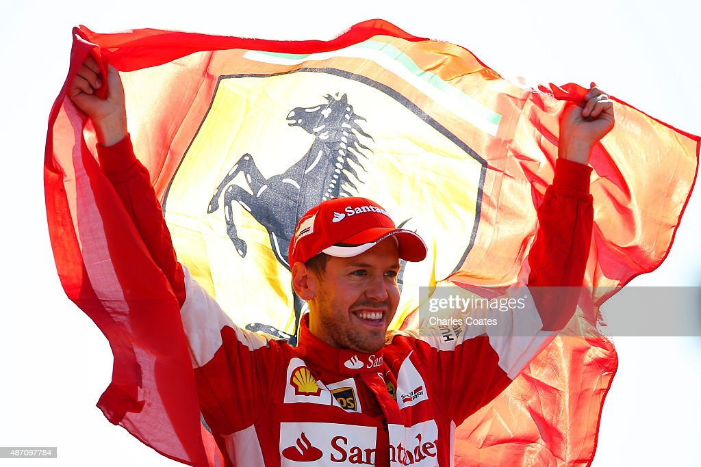 <a gi-track='captionPersonalityLinkClicked' href=/galleries/search?phrase=Sebastian+Vettel&family=editorial&specificpeople=2233605 ng-click='$event.stopPropagation()'>Sebastian Vettel</a> of Germany and Ferrari celebrates on the podium after finishing second in the Formula One Grand Prix of Italy at Autodromo di Monza on September 6, 2015 in Monza, Italy.