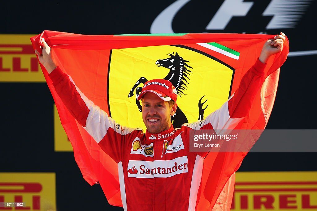 Sebastian Vettel of Germany and Ferrari celebrates on the podium after finishing second in the Formula One Grand Prix of Italy at Autodromo di Monza on September 6, 2015 in Monza, Italy.