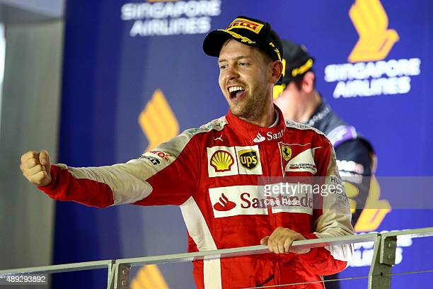 Sebastian Vettel of Germany and Ferrari celebrates on the podium after winning the Formula One Grand Prix of Singapore at Marina Bay Street Circuit...