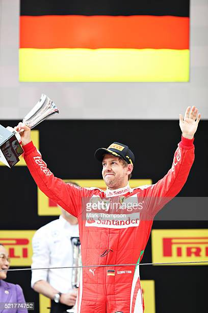 Sebastian Vettel of Germany and Ferrari celebrates on the podium during the Formula One Grand Prix of China at Shanghai International Circuit on...