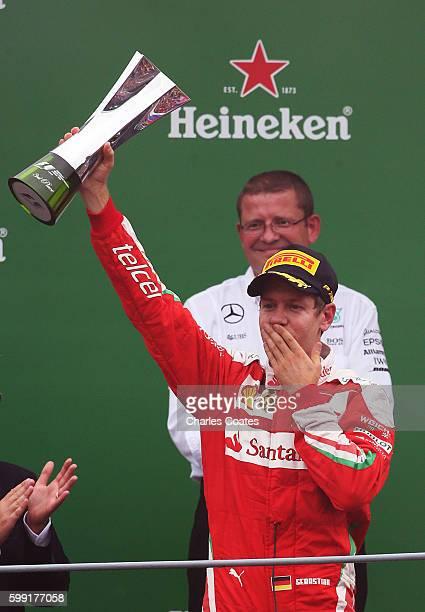 Sebastian Vettel of Germany and Ferrari celebrates on the podium during the Formula One Grand Prix of Italy at Autodromo di Monza on September 4 2016...
