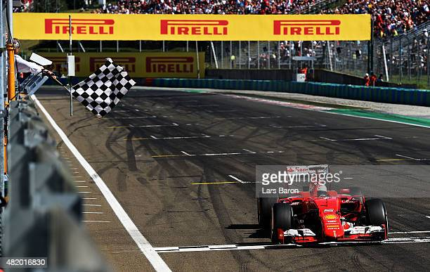 Sebastian Vettel of Germany and Ferrari celebrates winning the Formula One Grand Prix of Hungary at Hungaroring on July 26 2015 in Budapest Hungary
