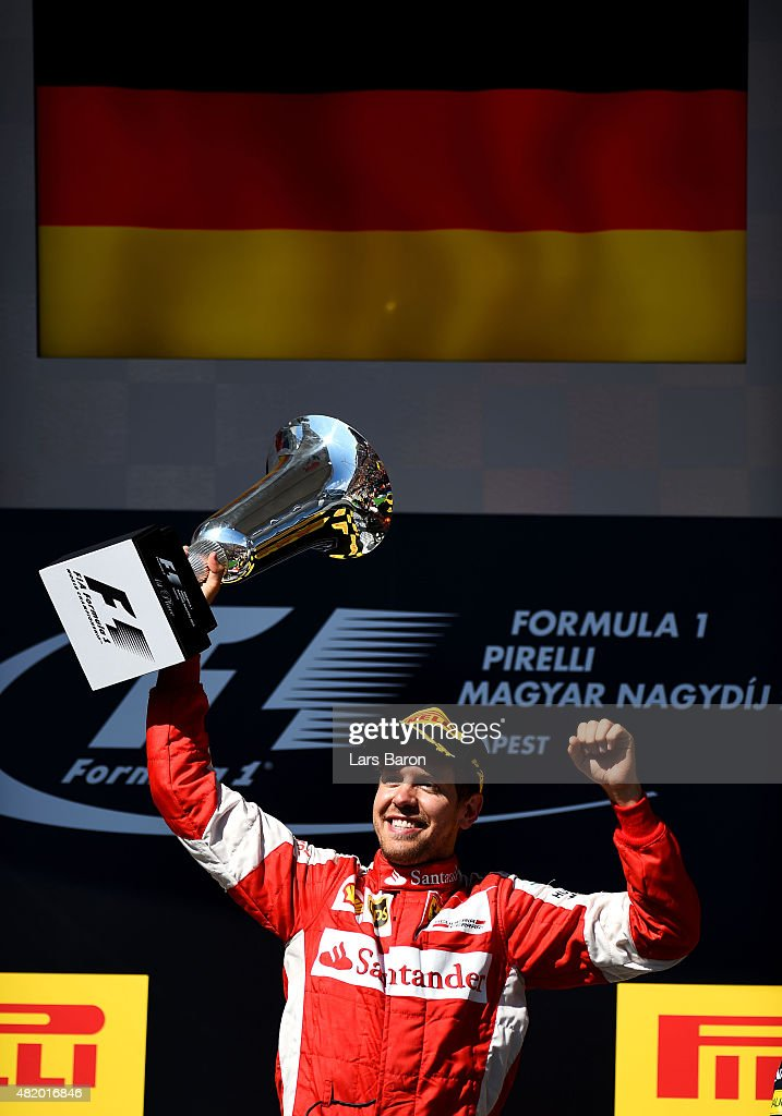 <a gi-track='captionPersonalityLinkClicked' href=/galleries/search?phrase=Sebastian+Vettel&family=editorial&specificpeople=2233605 ng-click='$event.stopPropagation()'>Sebastian Vettel</a> of Germany and Ferrari celebrates with the trophy after winning the Formula One Grand Prix of Hungary at Hungaroring on July 26, 2015 in Budapest, Hungary.
