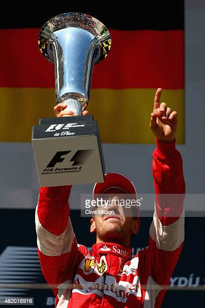Sebastian Vettel of Germany and Ferrari celebrates with the trophy after winning the Formula One Grand Prix of Hungary at Hungaroring on July 26 2015...