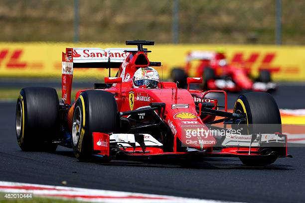 Sebastian Vettel of Germany and Ferrari drives ahead of Kimi Raikkonen of Finland and Ferrari during the Formula One Grand Prix of Hungary at...