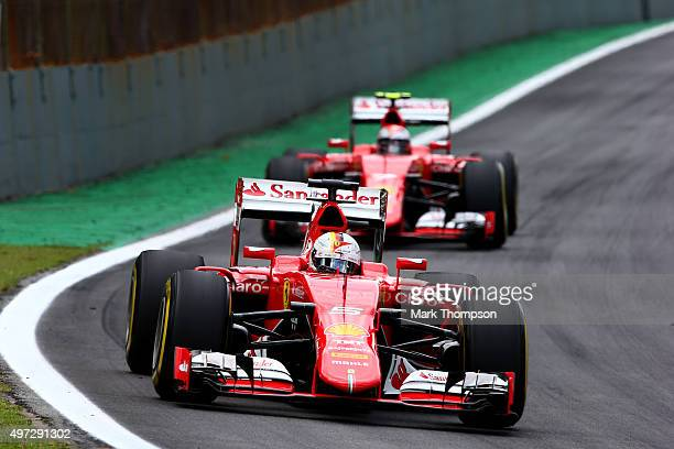 Sebastian Vettel of Germany and Ferrari drives ahead of Kimi Raikkonen of Finland and Ferrari during the Formula One Grand Prix of Brazil at...