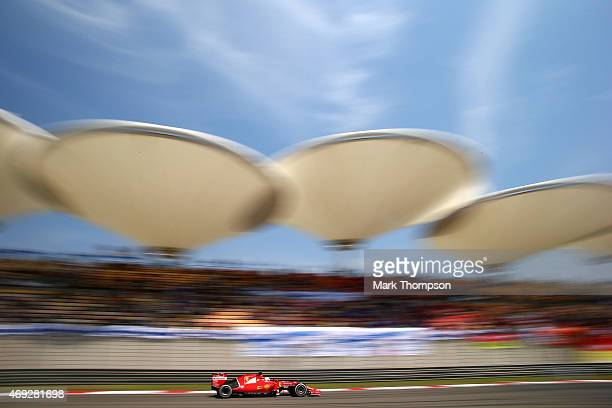 Sebastian Vettel of Germany and Ferrari drives during final practice for the Formula One Grand Prix of China at Shanghai International Circuit on...