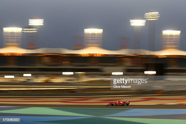 Sebastian Vettel of Germany and Ferrari drives during practice for the Bahrain Formula One Grand Prix at Bahrain International Circuit on April 17...