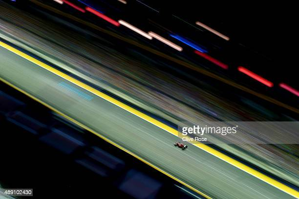 Sebastian Vettel of Germany and Ferrari drives during qualifying for the Formula One Grand Prix of Singapore at Marina Bay Street Circuit on...