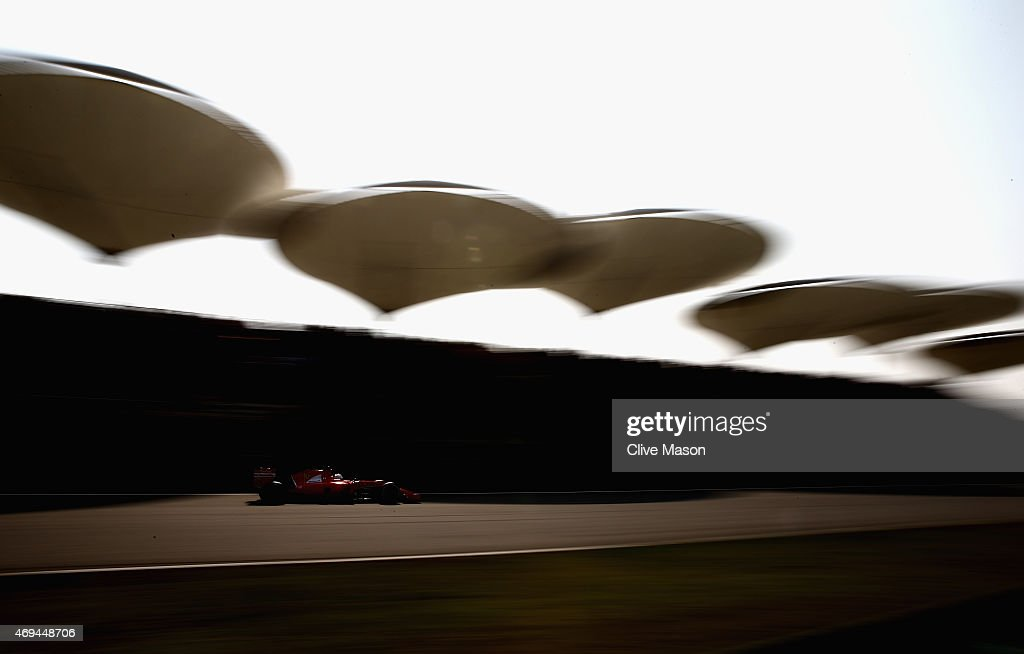 Sebastian Vettel of Germany and Ferrari drives during the Formula One Grand Prix of China at Shanghai International Circuit on April 12 2015 in...