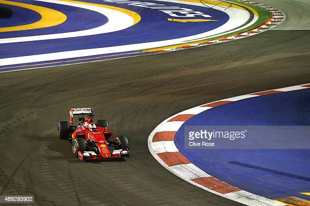 Sebastian Vettel of Germany and Ferrari drives during the Formula One Grand Prix of Singapore at Marina Bay Street Circuit on September 20 2015 in...