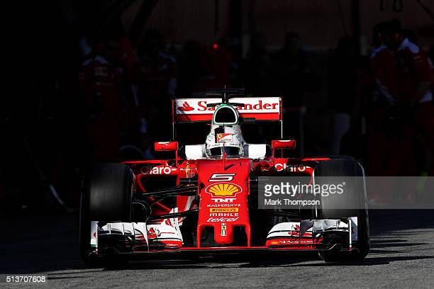 Sebastian Vettel of Germany and Ferrari drives in the pit lane after returning to the garage for a tyre change during day four of F1 winter testing...