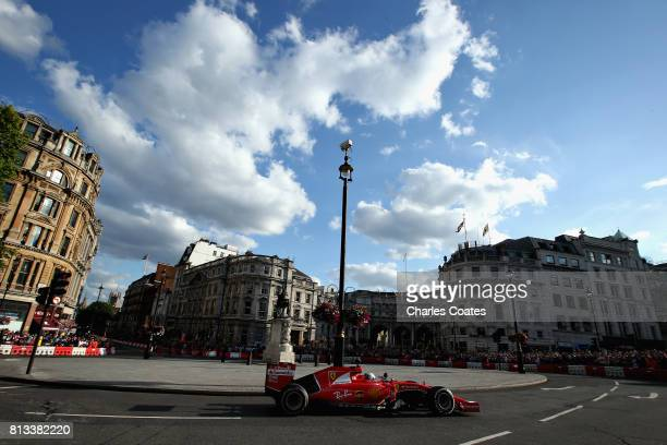 Sebastian Vettel of Germany and Ferrari drives the Ferrari SF15T during F1 Live London at Trafalgar Square on July 12 2017 in London England F1 Live...