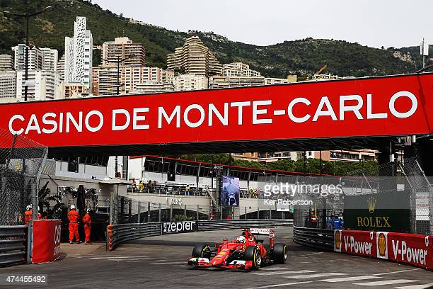 Sebastian Vettel of Germany and Ferrari drives through Rascasse corner during final practice for the Monaco Formula One Grand Prix at Circuit de...