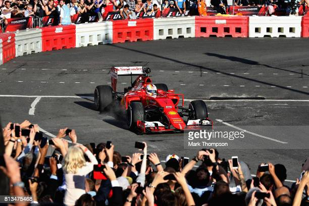 Sebastian Vettel of Germany and Ferrari driving the Ferrari SF15T during F1 Live London at Trafalgar Square on July 12 2017 in London England F1 Live...