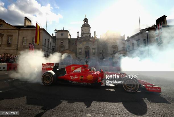 Sebastian Vettel of Germany and Ferrari driving the Scuderia Ferrari SF15T during F1 Live London at Trafalgar Square on July 12 2017 in London...