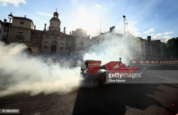 Sebastian Vettel of Germany and Ferrari driving the Scuderia Ferrari SF15T during F1 Live London at Trafalgar Square on July 12 2017 in London...