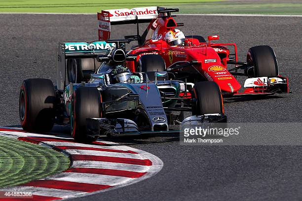 Sebastian Vettel of Germany and Ferrari follows Nico Rosberg of Germany and Mercedes GP during day four of the final Formula One Winter Testing at...