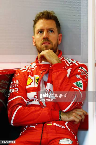 Sebastian Vettel of Germany and Ferrari in the garage during practice for the Australian Formula One Grand Prix at Albert Park on March 24 2017 in...