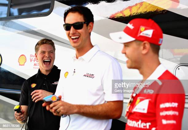 Sebastian Vettel of Germany and Ferrari IndyCar driver Josef Newgarden of USA and Team Penske and NASCAR driver Joey Logano of USA and Team Penske at...